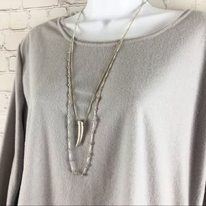 Layering silver necklaces